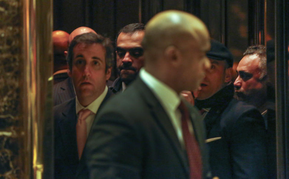 FILE - In this Dec. 12, 2016 file photo, Los Angeles venture capitalist Imaad Zuberi, right, stands in an elevator at Trump Tower in New York. At left is former Donald Trump attorney Michael Cohen. Prosecutors revealed in 2020 that there is an investigation into Zuberi's ties to Qatar. Zuberi secretly lobbied the Trump White House and Congress on behalf of the small gas-rich monarchy, which has paid him $9.8 million, prosecutors have alleged in court papers. (AP Photo/Kathy Willens)