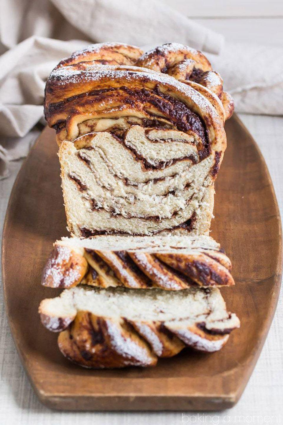 "<p>Serve this bread at breakfast with coffee or as an afternoon snack with hot chai tea.</p><p><strong>Get the recipe at <a href=""https://bakingamoment.com/apple-butter-cinnamon-swirl-bread/"" rel=""nofollow noopener"" target=""_blank"" data-ylk=""slk:Baking a Moment"" class=""link rapid-noclick-resp"">Baking a Moment</a>.</strong></p><p><a class=""link rapid-noclick-resp"" href=""https://www.amazon.com/dp/B0002L0ZMK?tag=syn-yahoo-20&ascsubtag=%5Bartid%7C10050.g.650%5Bsrc%7Cyahoo-us"" rel=""nofollow noopener"" target=""_blank"" data-ylk=""slk:SHOP BREAD PANS"">SHOP BREAD PANS</a><br></p>"