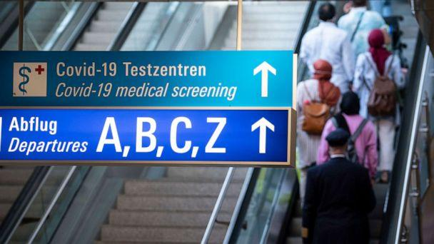 PHOTO: A sign in the arrivals area of Frankfurt Airport shows the way to departures and the Covid-19 test centers, Aug. 15, 2020. (Picture Alliance via Getty Images)