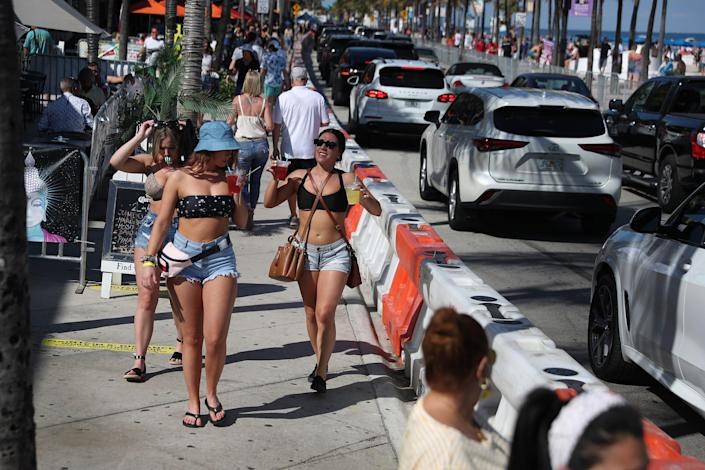 People walk near the beach on March 04, 2021 in Fort Lauderdale, Florida.