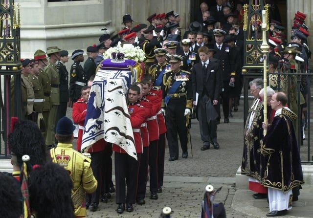 The Queen Mother's coffin being carried from Westminster Abbey