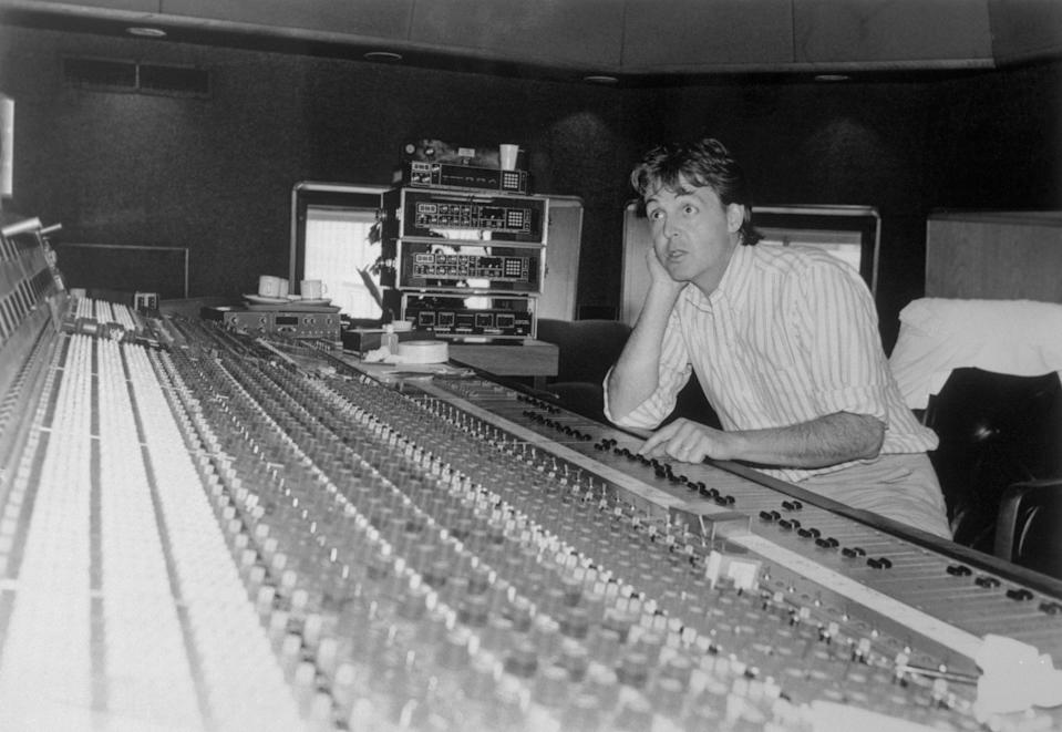 (Original Caption) Sporting a preppie style button-down shirt and khakis, Paul McCartney was hard at work, late last month, at Air Studios mixing sound for his cartoon, Rupert the Bear.