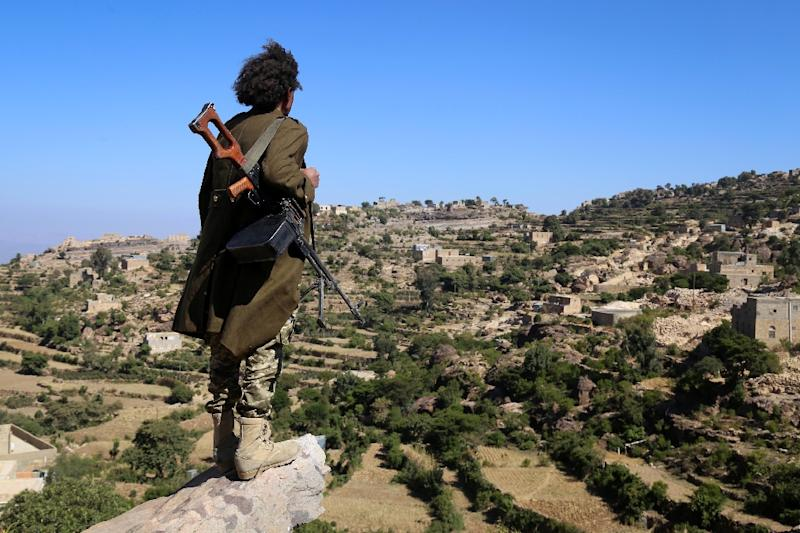 A Yemeni tribesman from the Popular Resistance Committee, supporting forces loyal to Saudi-backed President Abedrabbo Mansour Hadi, stands on a hill in the central city of Taiz, on November 1, 2016
