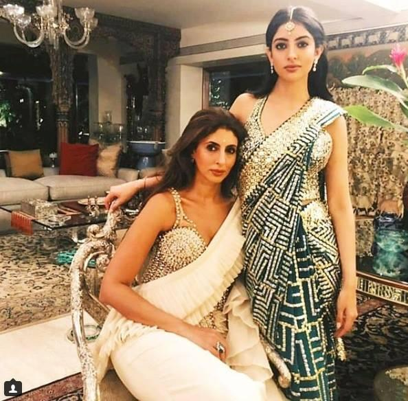<p></p><p>Navya became a hit with the netizens the very moment her pics from the much-hyped Ambani engagement hit the worldwide websites. Dressed in this extravagantly embellished designer saree complete with a sexy halter neck blouse, we won't be lying, if we said, the 21 year old stole the bride-to-be's thunder. </p><p></p>