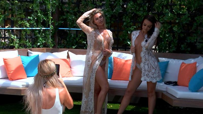 Little bit awkward: Megan and Rosie get their clothes off (ITV)