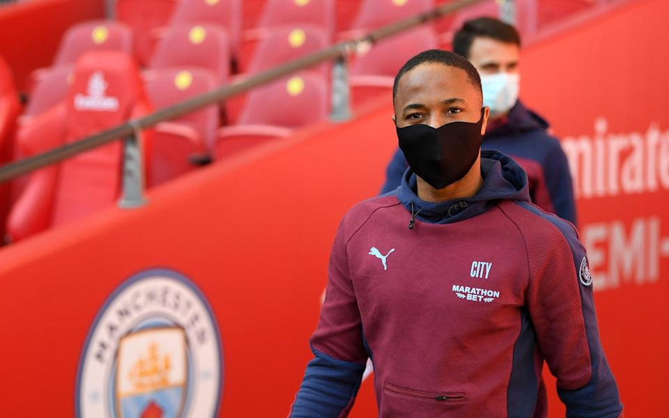 Raheem Sterling of Manchester City walks out for a pitch inspection prior to the Semi Final of the Emirates FA Cup match between Manchester City and Chelsea FC - Getty Images