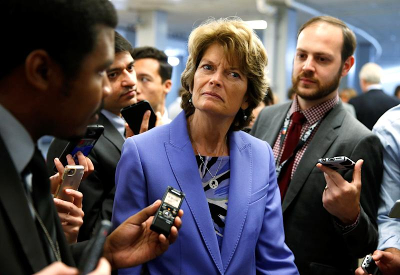 Sen. Lisa Murkowski (R-Alaska) being coy with reporters on how she'll vote on yet another Obamacare repeal bill. (Joshua Roberts / Reuters)