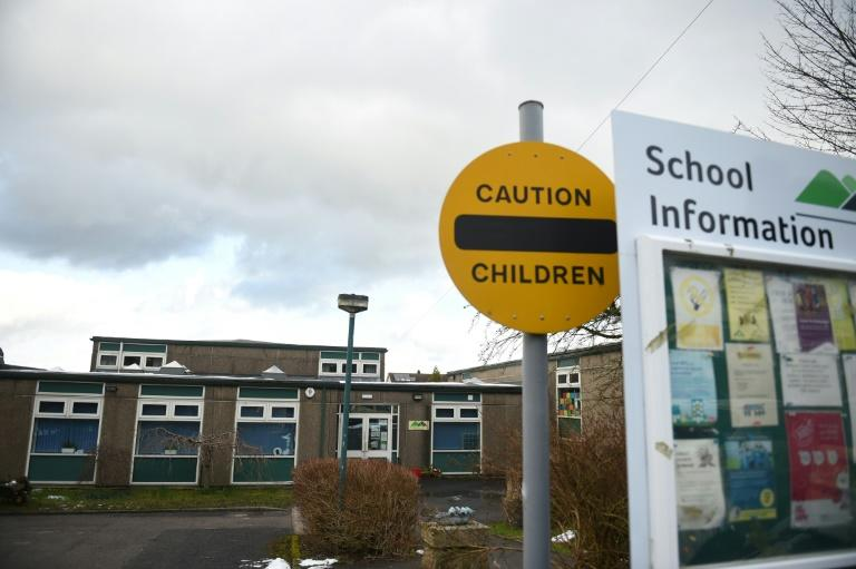 The British government has stopped short of closing schools in face of the coronavirus pandemic