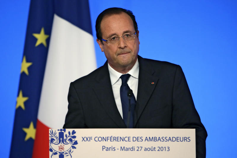 French President Francois Hollande delivers his speech during a conference with France's ambassadors, at the Elysee Palace, in Paris, Tuesday Aug. 27, 2013. Francois Hollande said France is prepared to take action against those responsible for gassing people in Syria.(AP Photo/Kenzo Tribouillard/Pool)
