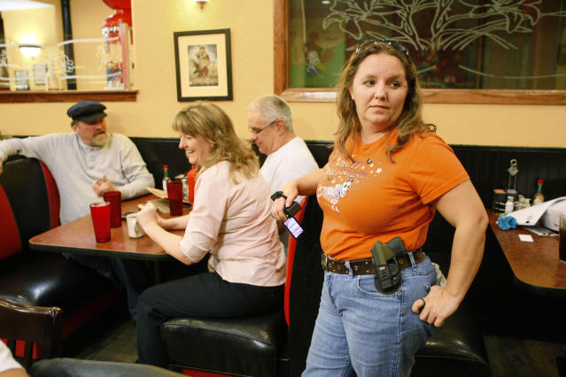 Morgan Meritt of Del City, Oklahoma, joins other members of the Oklahoma Open Carry Association (OKOCA) wearing unconcealed side arms as they gather at Beverly's Pancake House in Oklahoma City November 1, 2012. A new Oklahoma law took effect November 1 allowing anyone with a concealed weapon license to carry their firearms openly in a holster or belt. REUTERS/Bill Waugh (UNITED STATES - Tags: SOCIETY POLITICS CRIME LAW)