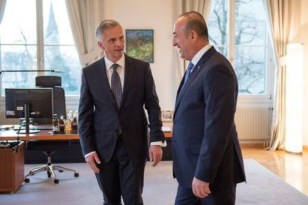 Turkey's Foreign Minister Mevlut Cavusoglu (R) and Switzerland's Federal Councillor Didier Burkhalter talk during Cavusoglu's visit to Switzerland follwing a weeks-long dispute between Turkey and several other European nations over campaigning by Turkish politicians, in Bern, Switzerland. March 23, 2017. REUTERS/Anthony Anex/Pool