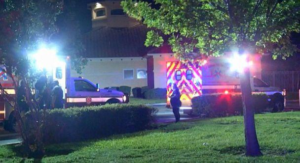 PHOTO: Ambulances sit outside the scene where a 15-year-old boy was hit and killed by a stray bullet while he was playing a video game inside his home in San Antonio, Texas, July 20, 2021. (KSAT)