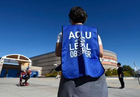 File photo: A member of the ACLU observes a polling station during voting in the 2016 presidential election at Desert Pines High School in Las Vegas, Nevada
