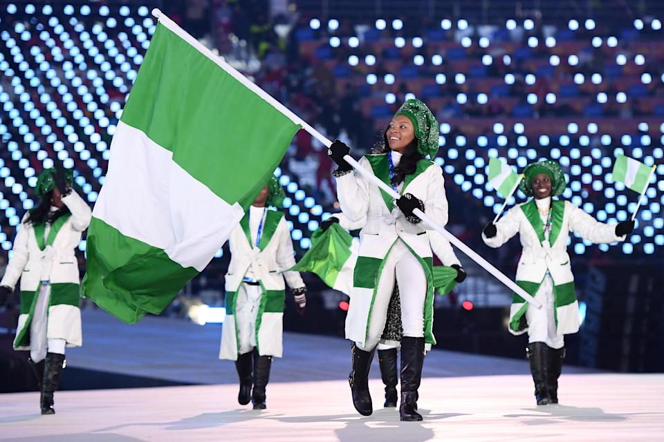 Team Nigeria wears winter-white and green coats with embellished geles, or headscarves. (Photo: Getty Images)