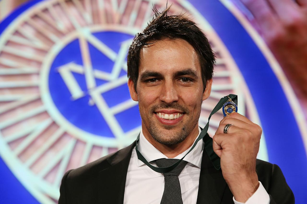SYDNEY, AUSTRALIA - JANUARY 20:  Mitchell Johnson poses after winning the Allan Border Medal during the 2014 Allan Border Medal at Doltone House on January 20, 2014 in Sydney, Australia.  (Photo by Mark Metcalfe/Getty Images)