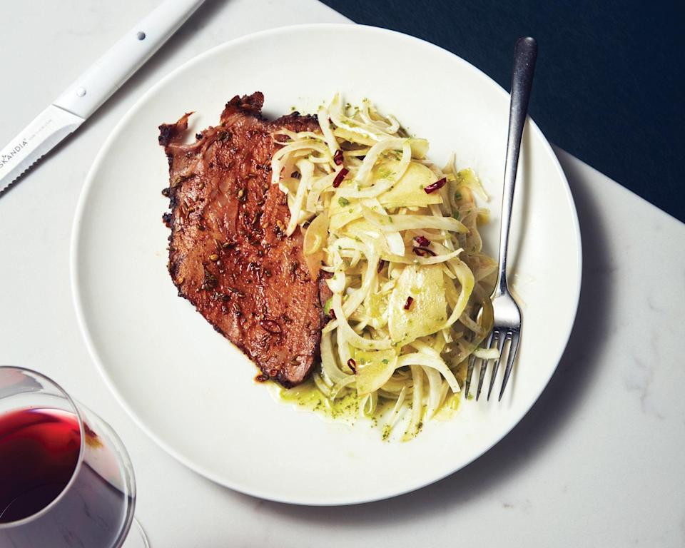 """<p>The chile paste for this pork is added in two stages: Initially it acts as a marinade and permeates the interior of the roast. After a second addition is applied, it's roasted over high heat to create a spicy, toasty bark. </p>   <p><em>Like this Bon Appétit recipe? There are plenty more where this came from.</em> <a href=""""https://subscribe.bonappetit.com/subscribe/bonappetit/122921?source=HCL_BNA_SUBSCRIBE_LINK_0_EPICURIOUS_ZZ"""" rel=""""nofollow noopener"""" target=""""_blank"""" data-ylk=""""slk:Subscribe to the magazine here!"""" class=""""link rapid-noclick-resp""""><em>Subscribe to the magazine here!</em></a></p>   <a href=""""https://www.epicurious.com/recipes/food/views/spiced-roast-pork-with-fennel-and-apple-salad?mbid=synd_yahoo_rss"""" rel=""""nofollow noopener"""" target=""""_blank"""" data-ylk=""""slk:See recipe."""" class=""""link rapid-noclick-resp"""">See recipe.</a>"""