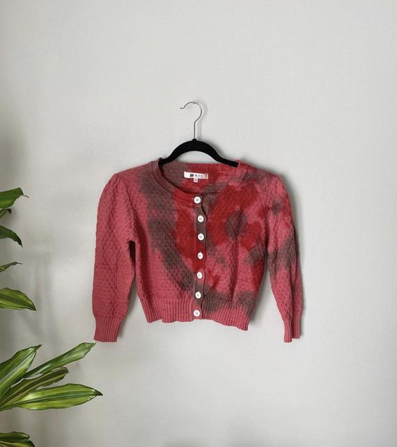 """<br><br><strong>CaseClosedGoods</strong> Red and Green Cardigan, $, available at <a href=""""https://go.skimresources.com/?id=30283X879131&url=https%3A%2F%2Fwww.etsy.com%2Flisting%2F806530215%2Fred-and-green-cardigan%3Fref%3Drelated-7%26pro%3D1%26frs%3D1"""" rel=""""nofollow noopener"""" target=""""_blank"""" data-ylk=""""slk:Etsy"""" class=""""link rapid-noclick-resp"""">Etsy</a>"""
