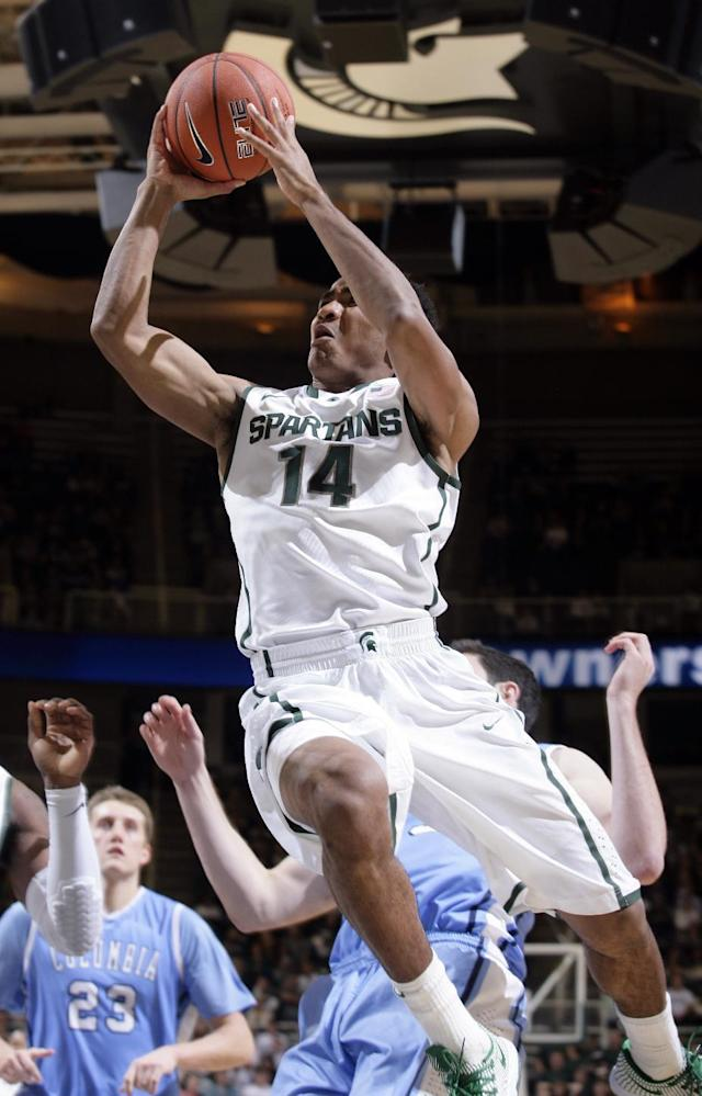 Michigan State's Gary Harris (14) puts up a driving shot against Columbia during the second half of an NCAA college basketball game Friday, Nov. 15, 2013, in East Lansing, Mich. Michigan State won 62-53. (AP Photo/Al Goldis)