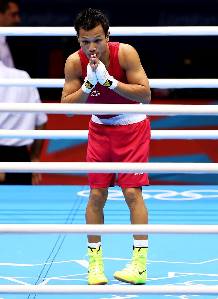 LONDON, ENGLAND - JULY 31:  Devendro Singh Laishram of India celebrates his victory over Bayron Molina Figueroa of Honduras during the Men's Light Fly (46-49kg) Boxing on Day 4 of the London 2012 Olympic Games at ExCeL on July 31, 2012 in London, England.  (Photo by Scott Heavey/Getty Images)