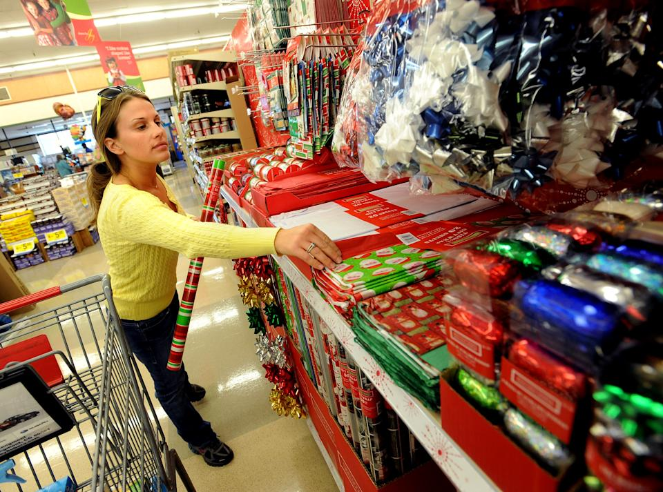 Sarah Roazenshops for Christmas wrapping paper at the 30th Street King Soopers in Boulder on November 5, 2010. (Photo by Cliff Grassmick/Digital First Media/Boulder Daily Camera via Getty Images)
