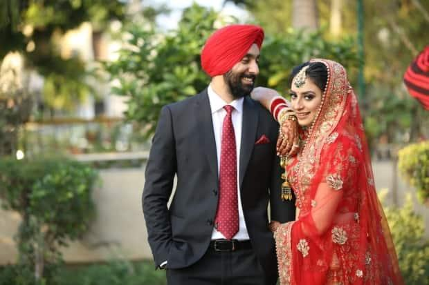 Ravdeep Singh Khanna, 31, and Chamanjot Kaur, 29,  were married in India in December 2019. It's been over a year since they've received an update on the status of Kaur's application to come to Canada from the Immigration Processing Centre in Mississauga, Ont. (Submitted by Ravdeep Singh Khanna - image credit)