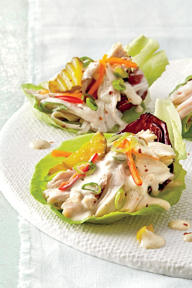 """<p><strong>Recipe: <a href=""""https://www.southernliving.com/syndication/slow-cooker-chicken-lettuce-cups"""">Slow-Cooker Chicken Lettuce Cups</a></strong></p> <p>This genius appetizer pairs the convenience of the slow cooker with fresh ingredients to make a riff on a taco that guests will love. For toppings, we chose green onion slices, sweet mini pepper slices, spicy pickles, and a sprinkling of dried crushed red pepper; but you can feel free to use whatever ingredients you like.</p>"""