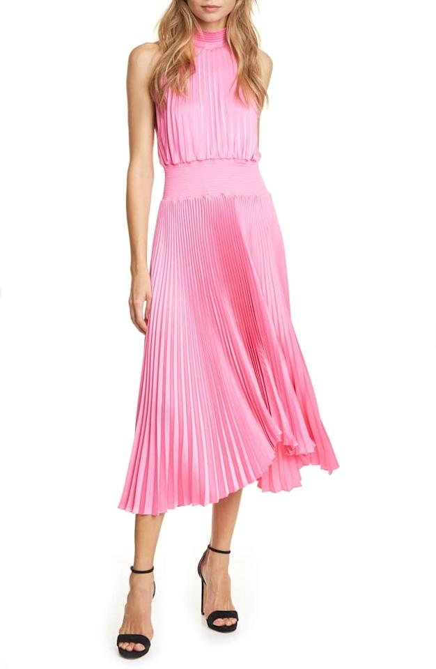 """<p>This <a href=""""https://www.popsugar.com/buy/LC-Renzo-Pleated-Sleeveless-Midi-Dress-533450?p_name=A.L.C.%20Renzo%20Pleated%20Sleeveless%20Midi%20Dress&retailer=shop.nordstrom.com&pid=533450&price=595&evar1=fab%3Aus&evar9=47030897&evar98=https%3A%2F%2Fwww.popsugar.com%2Fphoto-gallery%2F47030897%2Fimage%2F47030987%2FLC-Renzo-Pleated-Sleeveless-Midi-Dress&list1=shopping%2Cdresses%2Choliday%2Csequins%2Cnew%20years%20eve%2Cnew%20year%2Cwinter%20fashion%2Choliday%20fashion&prop13=api&pdata=1"""" rel=""""nofollow"""" data-shoppable-link=""""1"""" target=""""_blank"""" class=""""ga-track"""" data-ga-category=""""Related"""" data-ga-label=""""https://shop.nordstrom.com/s/a-l-c-renzo-pleated-sleeveless-midi-dress/5442364/full?origin=category-personalizedsort&amp;breadcrumb=Home%2FWomen%2FClothing%2FDresses%2FCocktail%20%26%20Party&amp;color=grapefruit"""" data-ga-action=""""In-Line Links"""">A.L.C. Renzo Pleated Sleeveless Midi Dress</a> ($595) is one that you can wear all year long.</p>"""