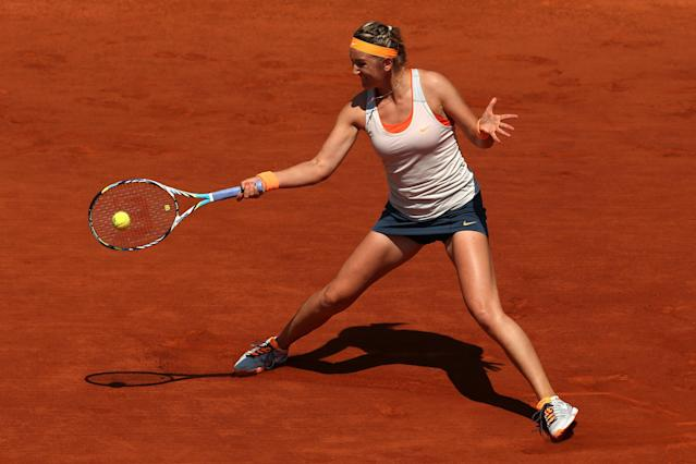 PARIS, FRANCE - JUNE 05: Victoria Azarenka of Belarus plays a forehand in her Womens' quarter final Singles match against Maria Kirilenko of Russia during day eleven of the French Open at Roland Garros on June 5, 2013 in Paris, France. (Photo by Matthew Stockman/Getty Images)