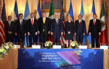 (L-R) El Salvador's Vice President Oscar Ortiz, Honduras' President Juan Orlando Hernandez, Mexico's Foreign Minister Luis Videgaray, U.S. Secretary of State Mike Pompeo, Vice President Mike Pence, Dept. of Homeland Security Kirstjen Nielsen, Mexico's Interior Minister Alfonso Navarrete and Guatemala's President Jimmy Morales pose for a group photo prior to the start of the Second Conference on Prosperity and Security in Central America, at the State Department, in Washington, U.S., October 11, 2018.              REUTERS/Mike Theiler