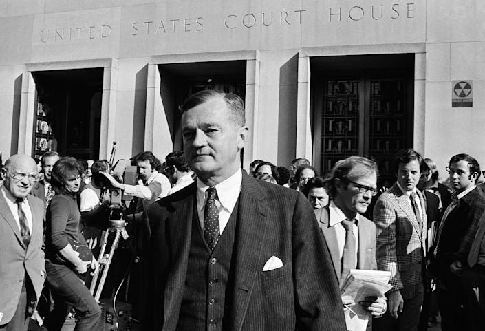 <p>Nixon's lawyer Charles Wright leaves the U.S. District Court in Washington after meeting with Judge John Sirica, Oct. 23, 1973. Wright told the judge that Nixon has agreed to let him hear the Watergate tapes. (Photo: Harvey Georges/AP) </p>