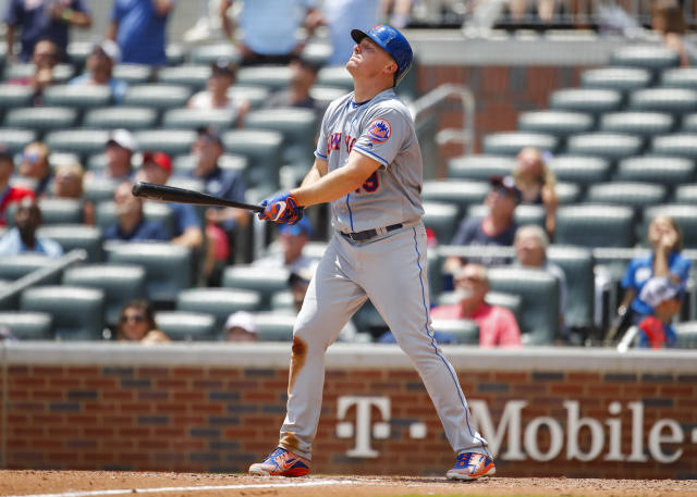 New York Mets' Jay Bruce reacts after popping up for the final out of the ninth inning of a baseball game against the Atlanta Braves, Wednesday, June 13, 2018, in Atlanta. The Braves beat the Mets 2-0. (AP Photo/Todd Kirkland)
