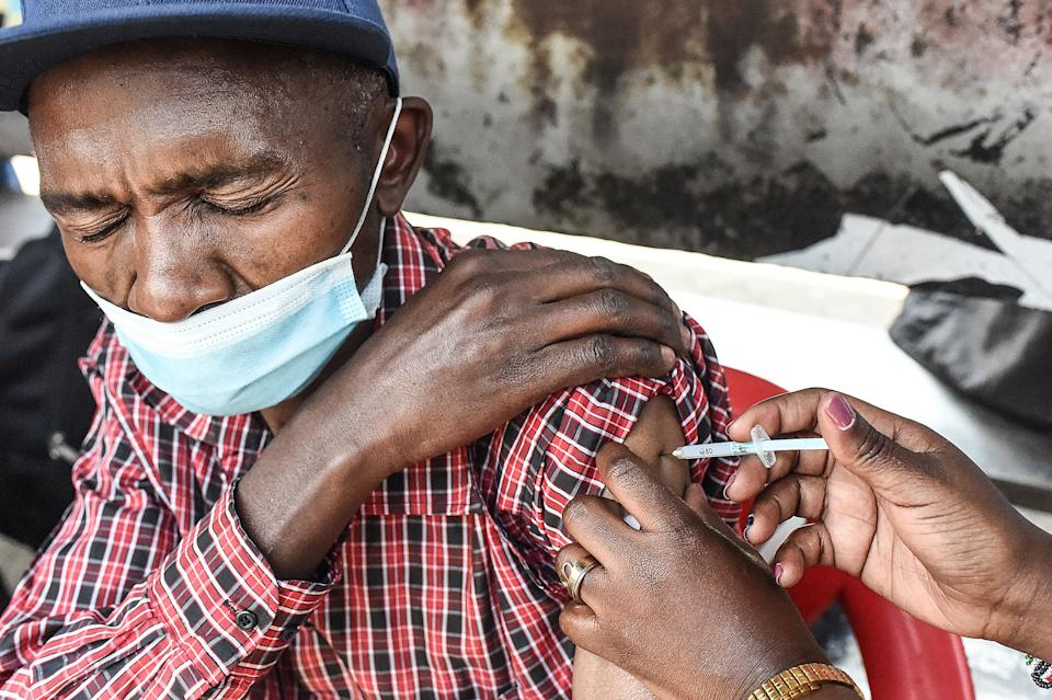 A man is inoculated with a Moderna Covid-19 vaccine in  Nairobi on September 17, 2021. (Photo by Simon MAINA / AFP) (Photo by SIMON MAINA/AFP via Getty Images)