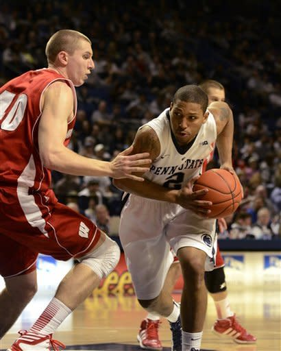 Penn State's D.J Newbill (2) moves around Wisconsin's Jared Berggren (40) during the first half of an NCAA college basketball game in State College, Pa., Sunday, March. 10, 2013. (AP Photo/Ralph Wilson)
