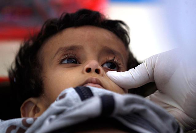 <p>A Yemeni child suspected of being infected with cholera receives treatment at a makeshift hospital in Sana'a on June 5, 2017.<br> Yemen is descending into total collapse, its people facing war, famine and a deadly outbreak of cholera, as the world watches, the UN aid chief said. (AFP/Getty Images) </p>