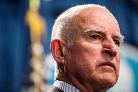 California Governor Jerry Brown looks on during a news conference at the State Capitol in Sacramento, California March 19, 2015, to announce a $1 billion emergency legislative package to deal with the state's devastating, multiyear drought. REUTERS/Max Whittaker