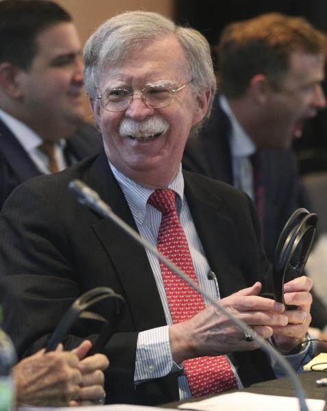 U.S. National security adviser John Bolton laughs during a conference of more than 50 nations that largely support Venezuelan opposition leader Juan Guaido in Lima, Peru, Tuesday, Aug. 6, 2019. Bolton said the U.S. will target anybody at home or abroad who supports the government of Venezuelan President Nicolas Maduro with stiff financial sanctions. Bolton spoke a day after the Trump administration announced a new round of sweeping measures aimed at pressuring Maduro from office. (AP Photo/Martin Mejia)