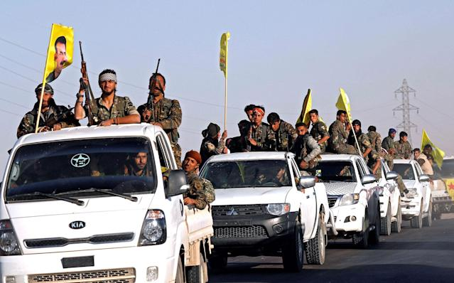 <p>Fighters of Syrian Democratic Forces ride on trucks as their convoy passes in Ain Issa, Syria, Oct. 16, 2017. (Photo: Erik De Castro/Reuters) </p>