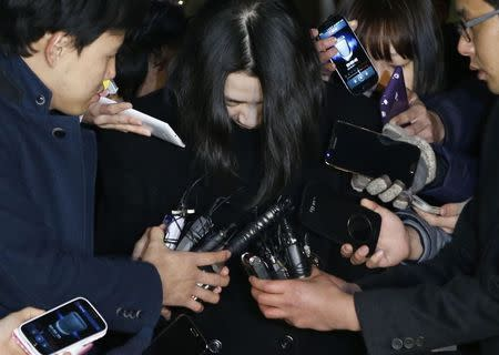 Cho Hyun-ah (C), also known as Heather Cho, daughter of chairman of Korean Air Lines, Cho Yang-ho, is surrounded by media as she leaves for a detention facility after a court ordered her to be detained, at the Seoul Western District Prosecutor's office December 30, 2014. REUTERS/Kim Hong-Ji