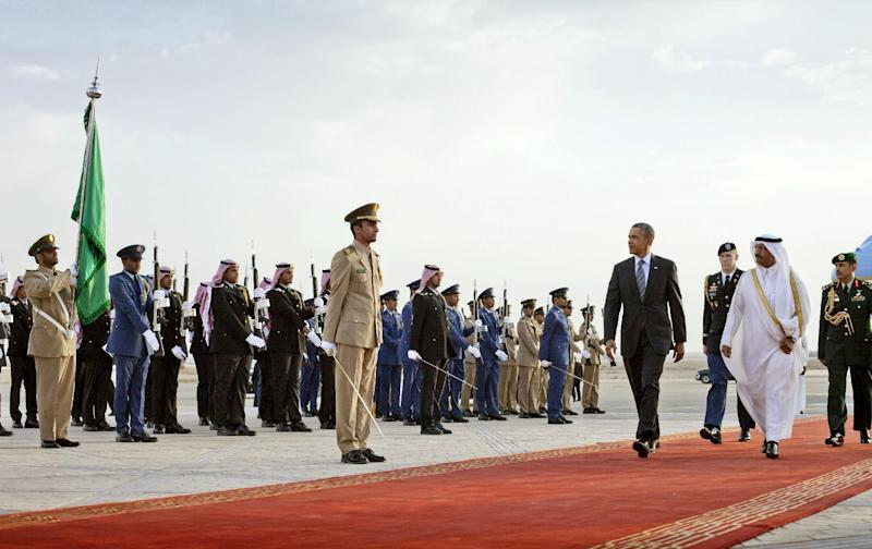 President Barack Obama walks during an arrival ceremony at King Khalid International airport in Riyadh, Saudi Arabia, Friday, March 28, 2014. President Barack Obama is in Saudi Arabia to reassure the key Gulf ally that his commitment to the Arab world isn't wavering. (AP Photo/Pablo Martinez Monsivais)