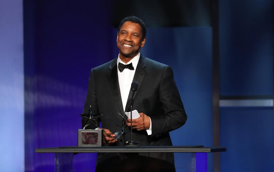 US actor honoree Denzel Washington speaks on stage during the 47th American Film Institute (AFI) Life Achievement Award Gala at the Dolby theatre in Hollywood on June 6, 2019. (Photo by Jean-Baptiste LACROIX / AFP)        (Photo credit should read JEAN-BAPTISTE LACROIX/AFP via Getty Images)