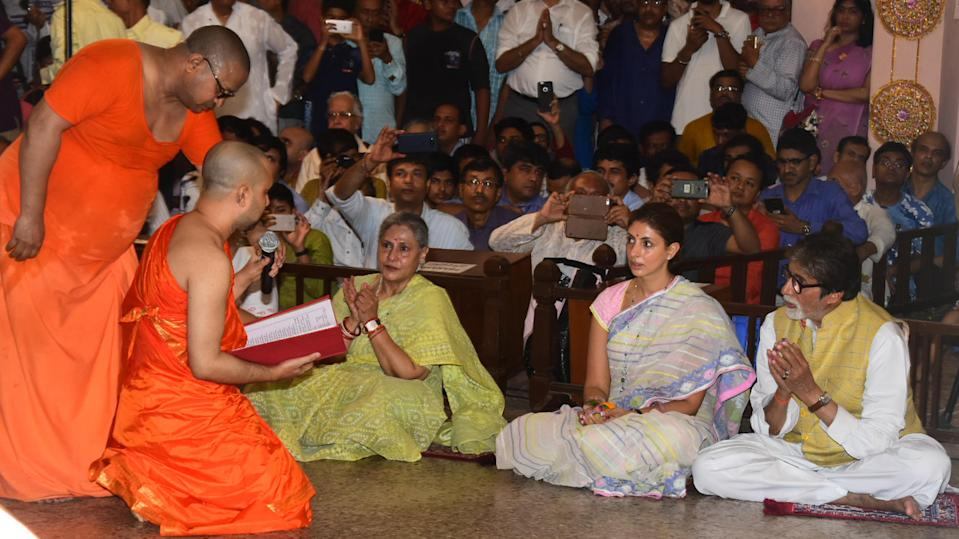 The Bachchans interact with pandal priests.