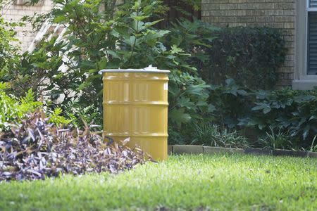 A metal barrel containing contaminated belongings of a health worker at the Texas Health Presbyterian Hospital who has contracted Ebola is in front of the health worker's residence in Dallas, Texas, October 12, 2014. REUTERS/Jaime R. Carrero
