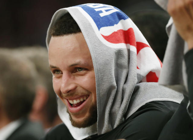 Golden State Warriors guard Stephen Curry laughs with teammates during the second half of an NBA basketball game, against the New York Knicks, Monday, Feb. 26, 2018 in New York. (AP)