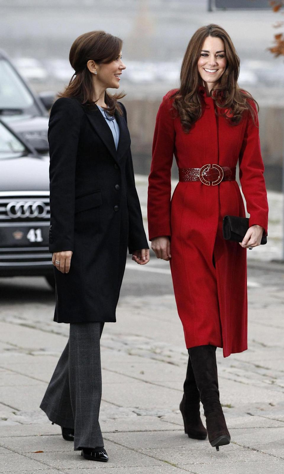 <p>Kate spent the day in Denmark wearing a rich red coat by L.K. Bennett and an ornate belt from Reiss. She finished with heeled Stuart Weitzman boots.</p><p><i>[Photo: PA]</i></p>