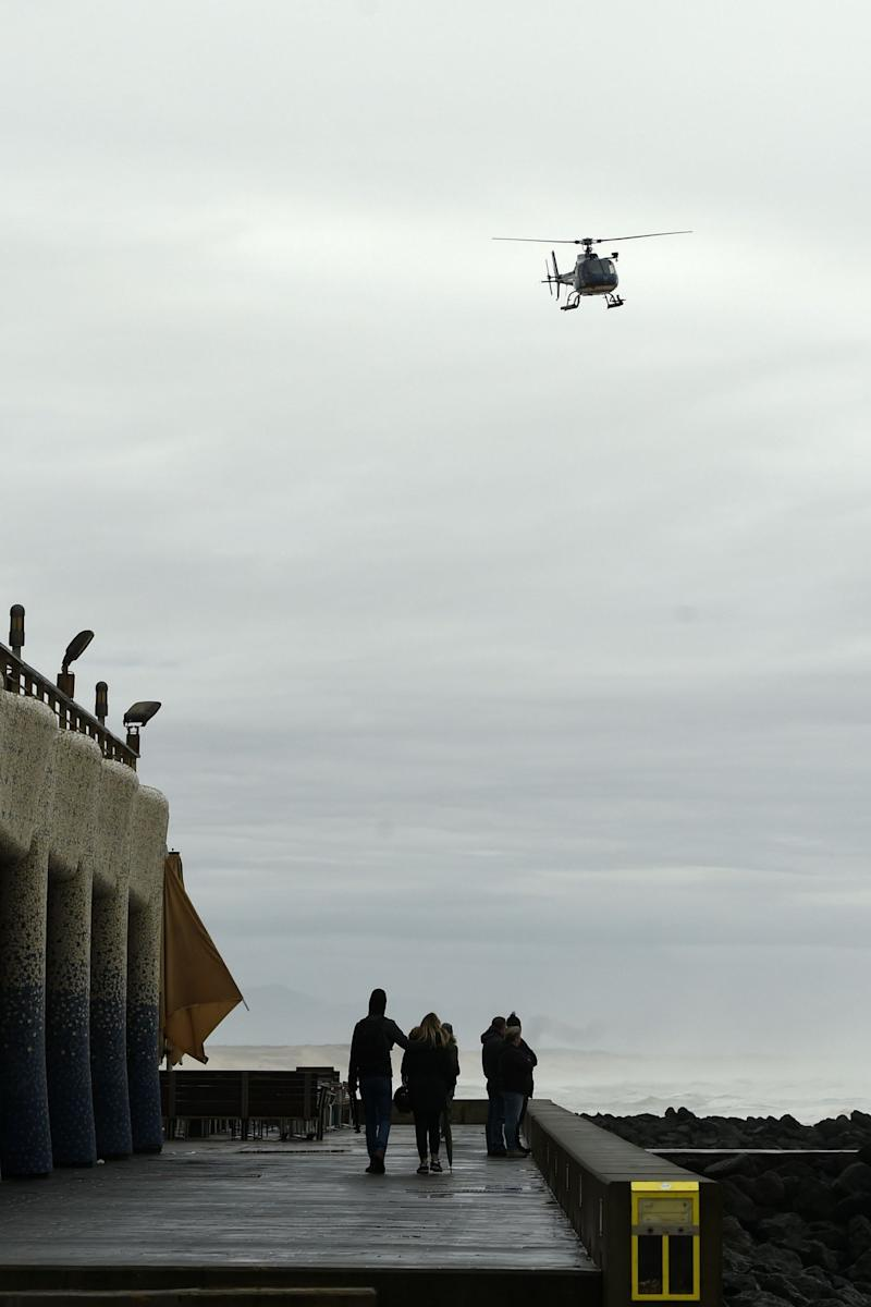 A gendarmerie helicopter flies over the beach on Monday in Capbreton, south-western France (AFP via Getty Images)