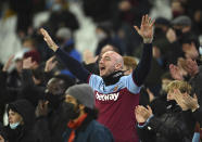 West Ham United fans cheer their team during the English Premier League soccer match between West Ham United and Manchester United at the London stadium in London, England, Saturday, Dec. 5, 2020. (Justin Setterfield/Pool Via AP)