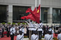 A flag raising ceremony is held at the Golden Bauhinia Square for the celebration of 24th anniversary of Hong Kong handover to China, in Hong Kong, Thursday, July 1, 2021. (AP Photo/Kin Cheung)