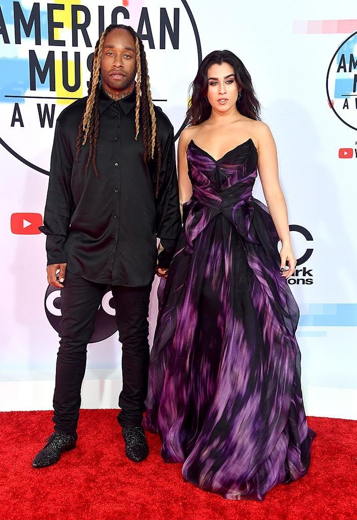 <p>Ty Dolla Sign (L) and Lauren Jauregui attend the 2018 American Music Awards at Microsoft Theater on Oct. 9, 2018, in Los Angeles. (Photo: Frazer Harrison/Getty Images) </p>