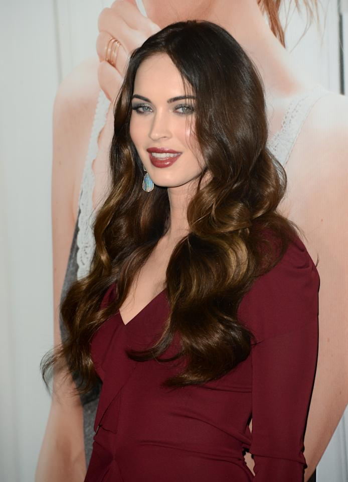"""HOLLYWOOD, CA - DECEMBER 12:  Actress Megan Fox attends the premiere Of Universal Pictures' """"This Is 40"""" at Grauman's Chinese Theatre on December 12, 2012 in Hollywood, California.  (Photo by Jason Merritt/Getty Images)"""