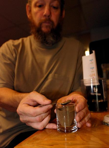 In this April 30, 2012 photo, co-owner Michael Shea displays some hashish available for smoking at the Earth Dragon Edibles Restaurant & Lounge in Ashland, Ore. While people have to pay for a bowl of stir-fried vegetables and meat at the restaurant for medical marijuana cardholders only, the hashish is free for registered medical marijuana patients. (AP Photo/Jeff Barnard)
